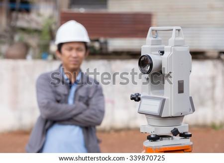 Surveyor equipment tacheometer or theodolite outdoors with engineer - stock photo