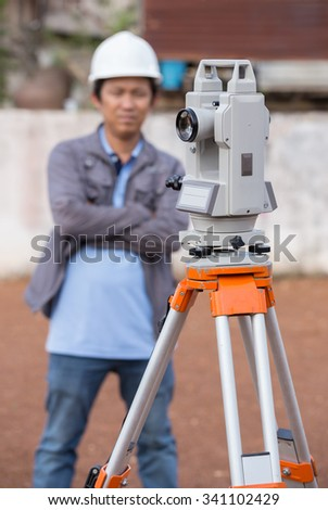 Surveyor equipment tacheometer or theodolite outdoors with engineer