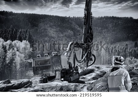surveyor measuring distances in rock-blasting and road-works industry - stock photo