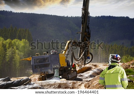 surveyor measuring rock-drilling for dynamiting, civil-engineering  - stock photo