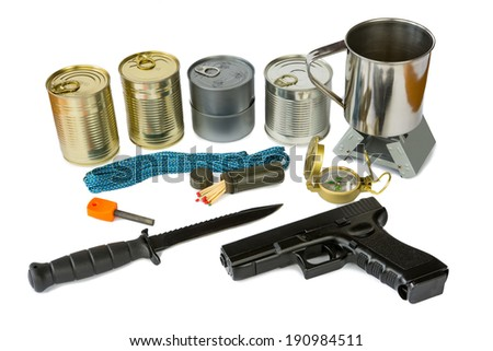 Survival kit with emergency supplies and gun - stock photo