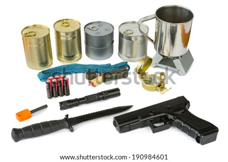 Survival kit with emergency supplies, flashlight and gun - stock photo