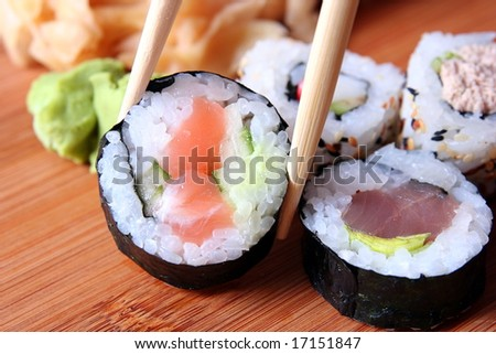 sushi and chopsticks close-up - stock photo