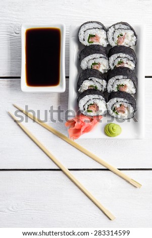 Sushi and roll with cream cheese and salmon fish inside. Top view.