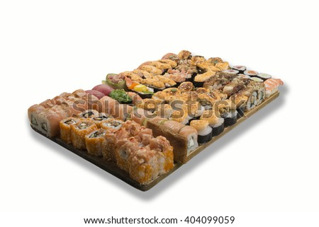 sushi and rolls on a wooden board