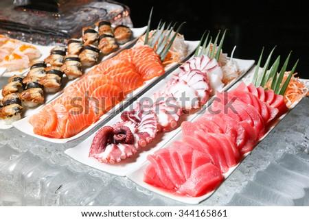 Sushi and Sashimi buffet line, Japanese food - stock photo