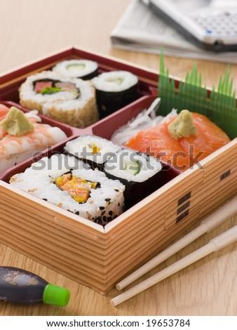 Sushi And Sashimi In A Take Away Bento Box - stock photo