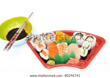 Sushi and Sashimi Lunchbox with soy sauce dish