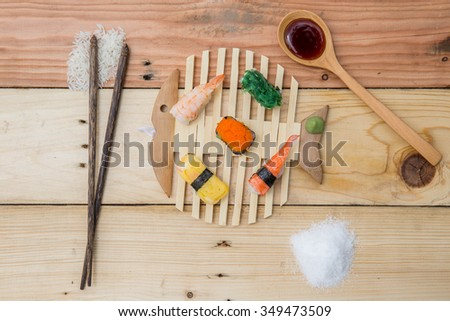 Sushi and sauce on wood background. - stock photo