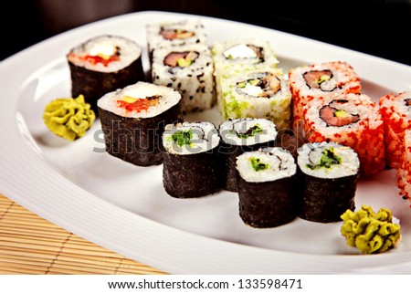 Sushi assortment served on white dish with wasabi - stock photo