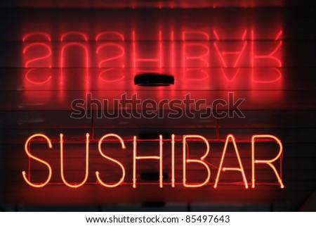 Sushi bar neon - stock photo