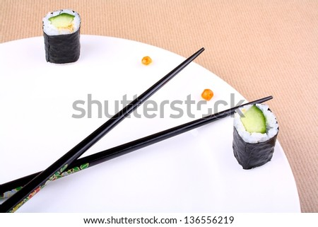 Sushi clock, time concept with caviar on white plate, close up