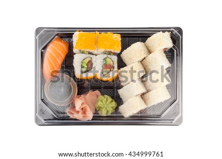 Sushi delivery box on white background. Japan menu in black transport box. Top view