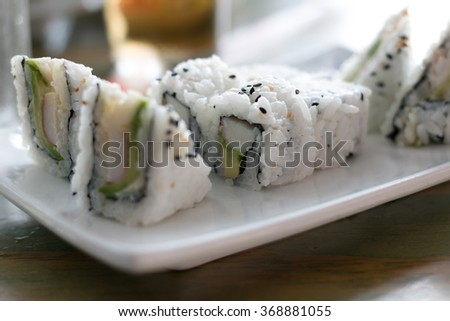 Sushi dish on plate at restaurant - stock photo