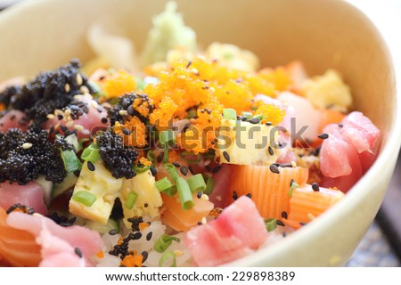 Sushi don , raw salmon tuna octopus on rice - stock photo