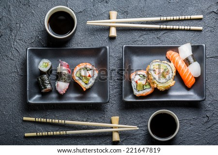 Sushi for two served on black stone - stock photo