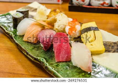 Sushi, Fresh traditional Japanese seafood set served on plate - stock photo