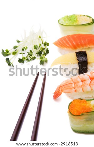 Sushi, green and chopsticks over white background