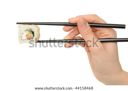 Sushi in a beautiful hand on a white background