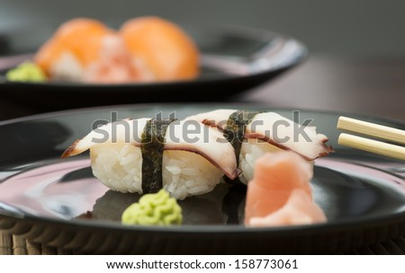 Sushi in sushi bar. Table and ration sushi