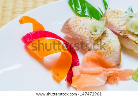 Sushi in white dish