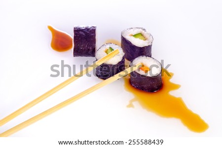 Sushi is a Japanese food consisting of cooked vinegared rice combined with other ingredients, seafood, vegetables and sometimes tropical fruits. - stock photo