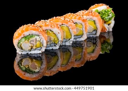 Sushi isolated on black background with reflection - stock photo