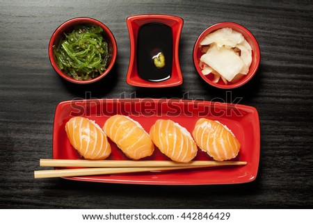 Sushi maki and nigiri on plate with chopsticks