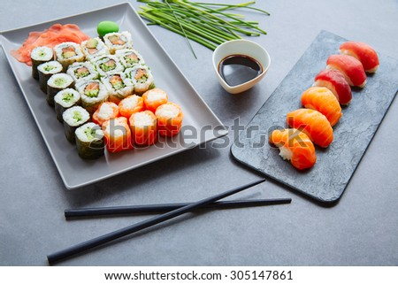 Sushi Maki and Niguiri California roll soy sauce and wasabi - stock photo