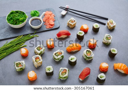 Sushi Maki and Niguiri California roll with seaweed chuka salad soy sauce and wasabi - stock photo