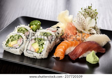 Sushi Maki roll assortment on black dish - stock photo