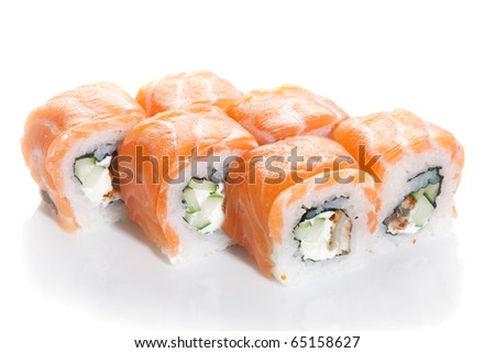 Sushi maki with salmon topping on white ground - stock photo