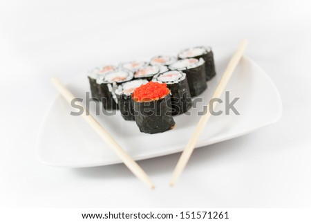 Sushi menu and chopsticks on plate, white background - stock photo