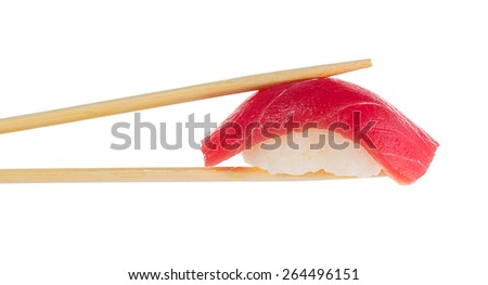 Sushi nigiri with chopsticks isolated on white - stock photo