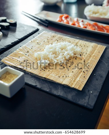 Sushi On A Plate Being Rolled