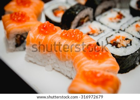 Sushi on a white plate. Rolls