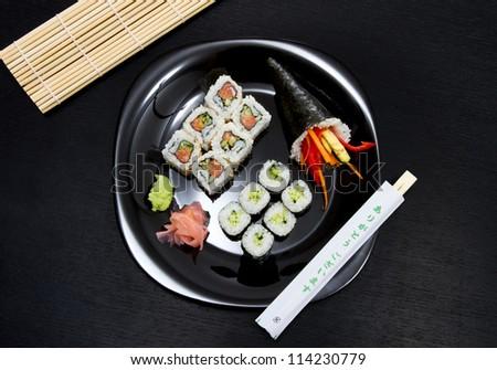 sushi on black background - stock photo