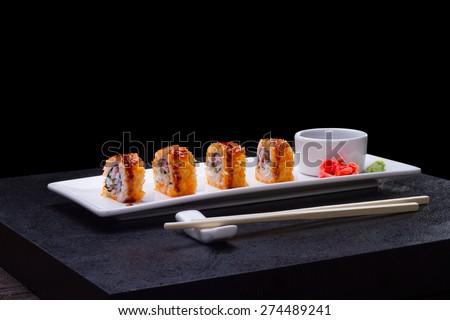Sushi over black background - stock photo