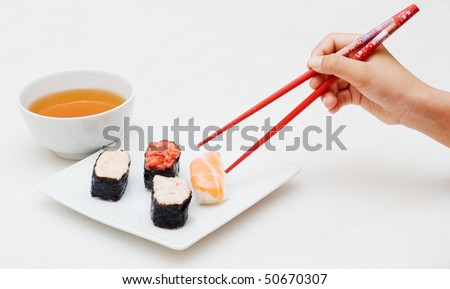 sushi pick by chopstick - stock photo