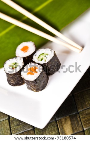 Sushi plate, close-up with chopsticks