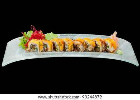 sushi plate isolated on black, studio shot - stock photo