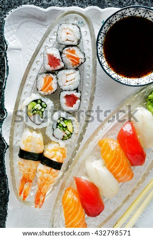 sushi Plate with Sushi Set nigiri and sushi rolls , maki, soy sauce, wasabi, chopsticks