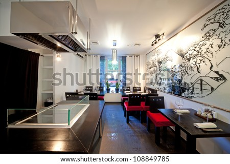 Sushi restaurant with picture on wall, indoor