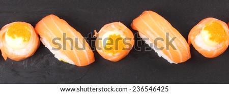 Sushi roll and salmon nigiri sushi in black plate - stock photo