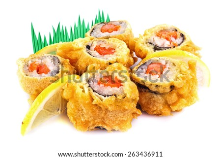 sushi roll fried in tempura batter with lemon isolated - stock photo