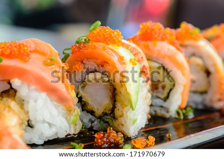 Sushi roll with salmon and shrimp tempura - stock photo