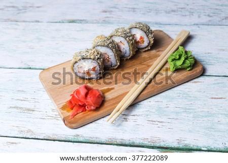 Sushi roll with salmon and shrimp tempura - stock photo
