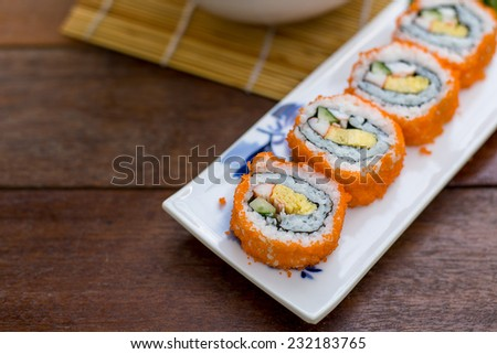 Sushi roll with salmon - Selective focus point - stock photo