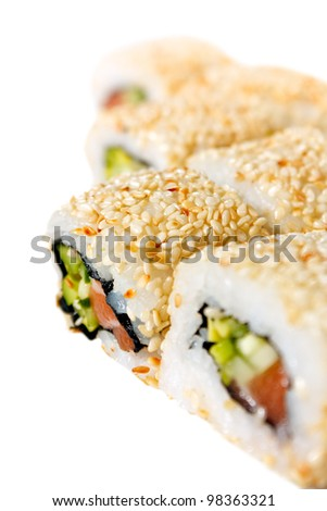Sushi Roll with salmon, sesame seeds, avocado and cucumber close-up. Isolated on white - stock photo