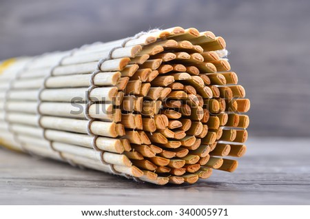 sushi rolling roller bamboo material mat maker - stock photo